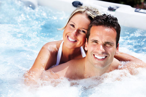 Couple relaxing in the hot tub, spa products